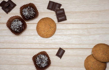 biscuits and chocolates on a wooden background Stock Photo