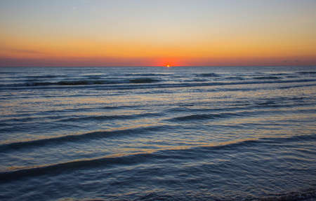 the seascape of the beginning of a new day, the sunrise in the sea