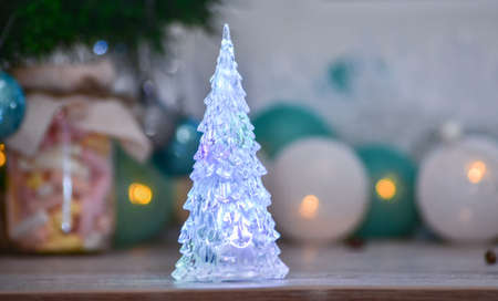 New Years icy Christmas tree on the background of garlands