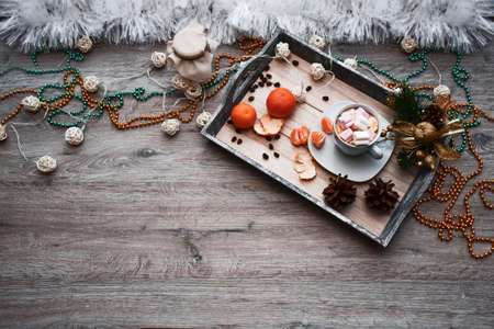 attributes of winter and new year on a wooden surface