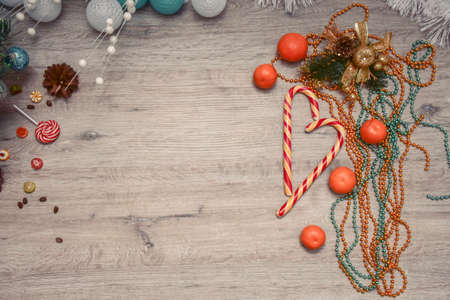 Christmas wooden background - textured wooden board with Christmas garland and free text space