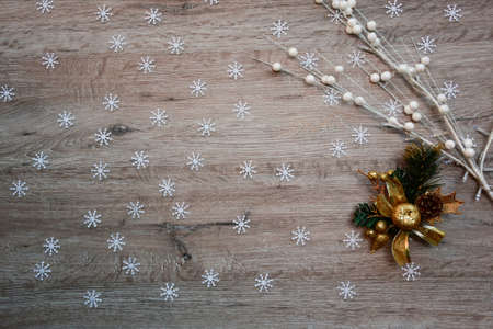 textured wooden surface for background decorated with snowflakes