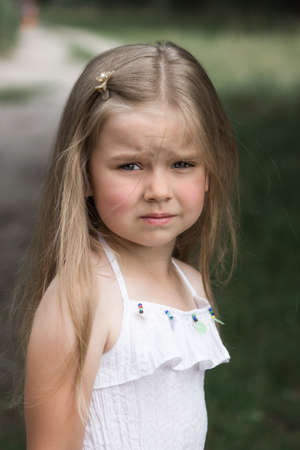 little girl looks displeased and resentful