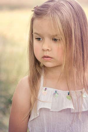 portrait of a very sad little girl