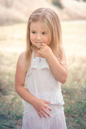 naughty little girl outdoors in summer