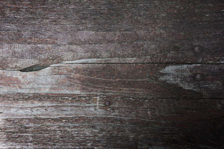 background of old wooden texture with peeling paint, hammered nails