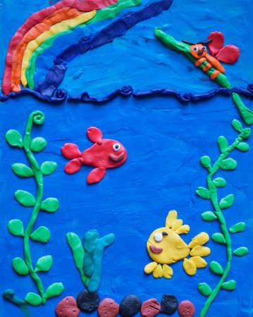 DIY plasticine craft for children. underwater world with fish and rainbow Stock Photo