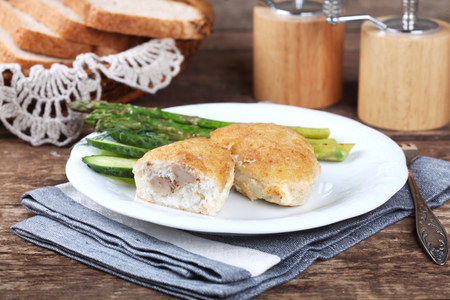 stuffed fish: Traditional Russian cuisine - homemade fish patties zrazy stuffed with cod liver on a wooden table. Rustic style and selective focus.