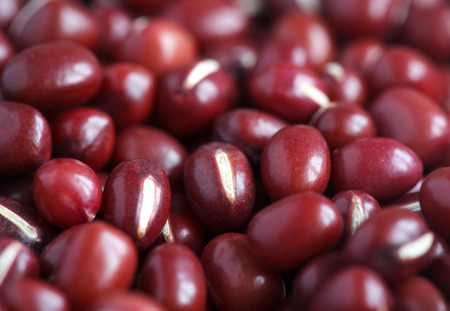 angularis: Dry red adzuki beans, macro, selective focus - some beans in focus, some are not