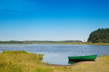 green boat: Landscape on the River Pra with green boat, Russia, nature reserve Meschera