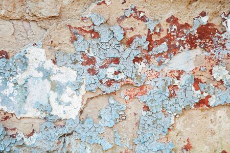 rotting: old paint concrete wall with blue cracked, texture, selective focus in center