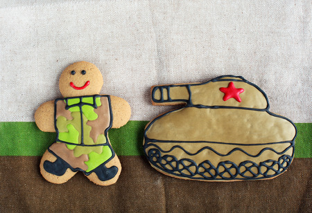 defender: Homemade Gingerbread man in protective khaki uniforms and the tank on Defender of the Fatherland Day
