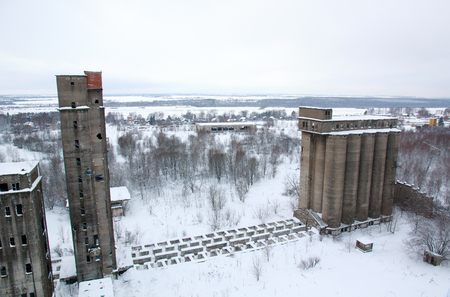 dilapidated: Abandoned dilapidated grain elevators, winter, Russia