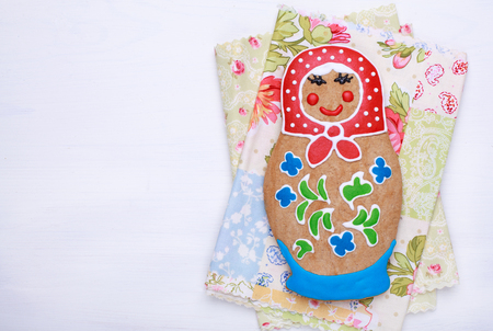 russian nesting dolls: Edible homemade gingerbread as a traditional Russian nesting dolls - matryoshka, on the white table, with place for text