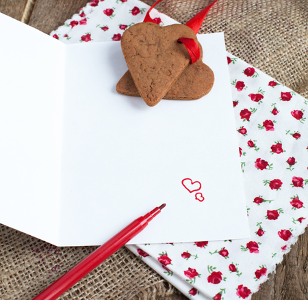 saint valentines: Saint Valentines Love letter with heart shape cookies, hearts and red felt pen in rustic style