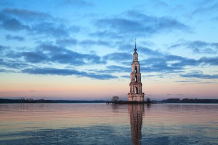 Famous and Beautiful Flooded Belltower on the River Volga at sunset. Kalyazin, Russia