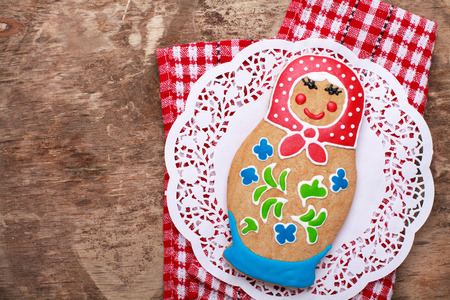 russian nesting dolls: Edible homemade gingerbread as a traditional Russian nesting dolls - matryoshka, on the wooden table