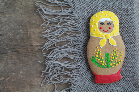 russian nesting dolls: Edible homemade gingerbread as a traditional Russian nesting dolls - matryoshka, on the wooden table, with place for text Stock Photo
