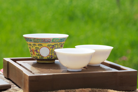 chinese tea ceremony: Traditional chinese tea ceremony accessories ( gaiwan and cups) on the tea table