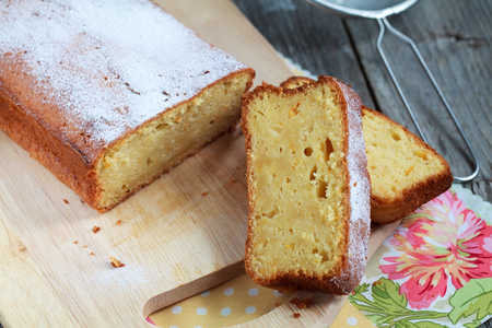 homemade Moist bread with orange juice and zest with the addition of almond flour, Selective focus on slices of cake