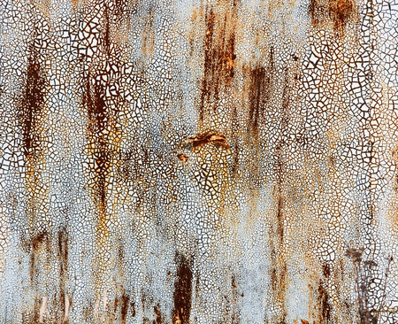 rust covered: Grunge background painted metal surface covered with small rust and cracked paint Stock Photo