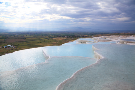 travertine: Pamukkale Travertine landscape with rock pools at evening