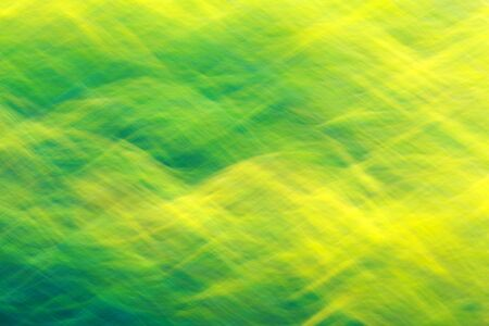light streaks: Photo art, bright Colorful light streaks abstract background in yellow and green colors, effect of movement