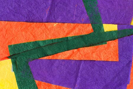 colored sheets of crumpled paper: orange, green, yellow, purple, on a white background