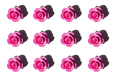 Artificial pink roses isolated on white background. Flat-lay, overview, holiday, Valentines Day concept