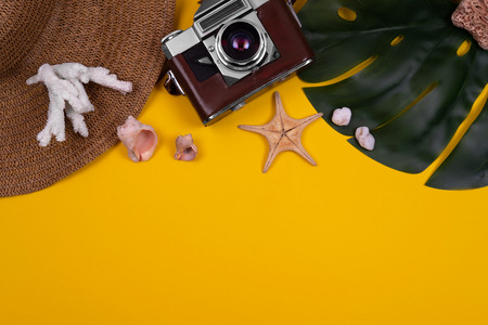 Womens traveler accessories: coral, shell, starfish, straw hat, tropical leaf monstera, retro camera on yellow background. Concept of travel with copy space. Summer background. Flat lay, overview 스톡 콘텐츠 - 124995070