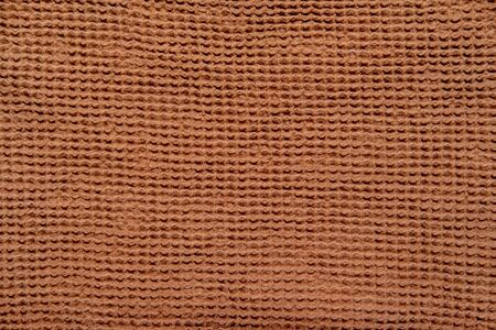 Natural eco brown cotton background with copyspace
