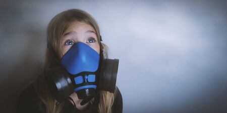 Young girl wearing gasmask, respirator portrait. Effects of worldwide air pollution, industrial influence on environment. Protection from dangerous air particles, gas, smog, transmitted diseases