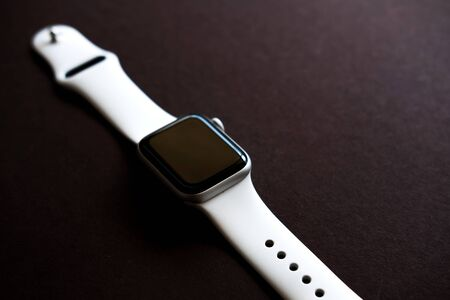 Chekhov, Russia - July 19, 2019: Apple Watch Series 4 white color. A new watch from an Apple company closeup isolated on dark background Editorial