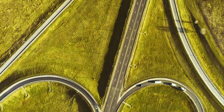 Drone view of morning empty country side road with beautiful green landscape around Stok Fotoğraf
