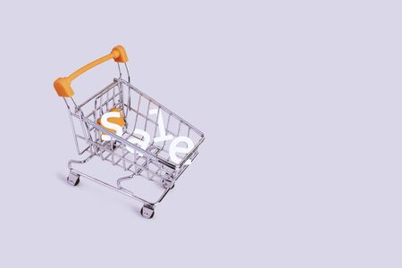 Banner with shopping cart and word sale. Grocery shopping and sale concept. Black friday, online shopping concept. Sale discount. Background with copyspace. Creative design. Stock photography.