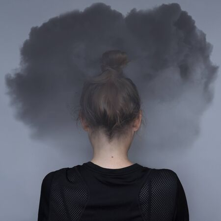 Girl with dark cloud on your head. Mental health care concept. Anxiety problem. Sad expression. Asian woman. Great design for any purposes. Stock photography.