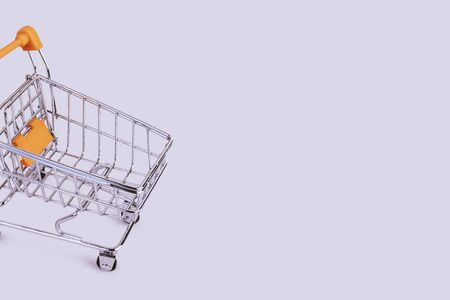 Banner with shopping cart. Grocery shopping and sale concept. Black friday, online shopping and store concept. Sale discount. Business background with copyspace. Creative design. Stock photography.