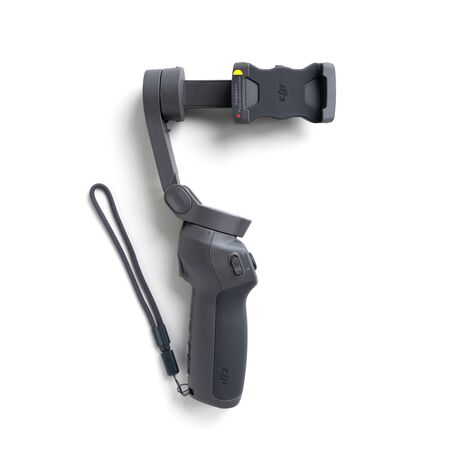 Chekhov, Russia - December 7, 2019: DJI Osmo Mobile 3 isolated on white background. Stabilizer for smartphone. Editorial