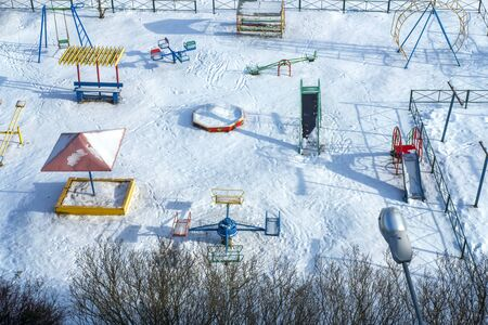 Playground with hard shadows. Sunny day.Bird eye view. Great background for any purposes. Winter and snow landscape. Stock photo.
