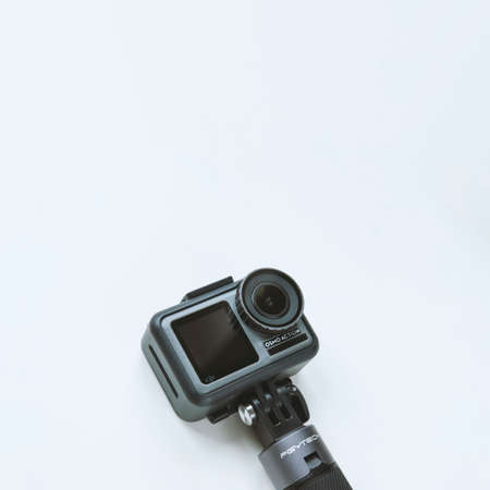 Chekhov, Russia - March 8, 2020: DJI Osmo Action isolated on white background. Action camera for photo and video.