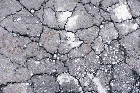 Waterless planet. Dry gray cracked earth. Hot climate and drought concept. Desert background Stock Photo