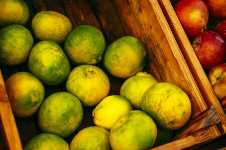 Exotic summer diet. Tropical organic fruit in crate. Tangerine delivery. Autumn harvest. Stock photo. Imagens