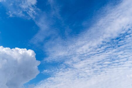 Bright pop blue sky with white clouds. Great background
