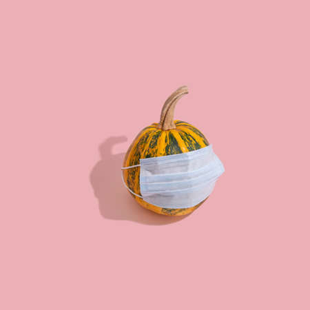Yellow pumpkin with green stripes.
