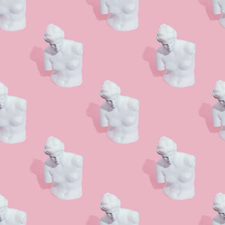 White woman statue on pink background Imagens