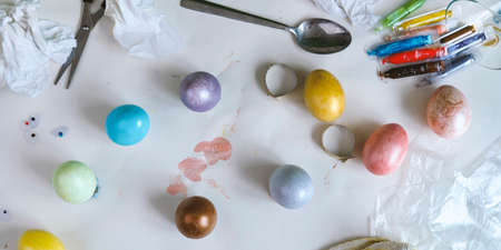 Colored easter eggs on paper gray background