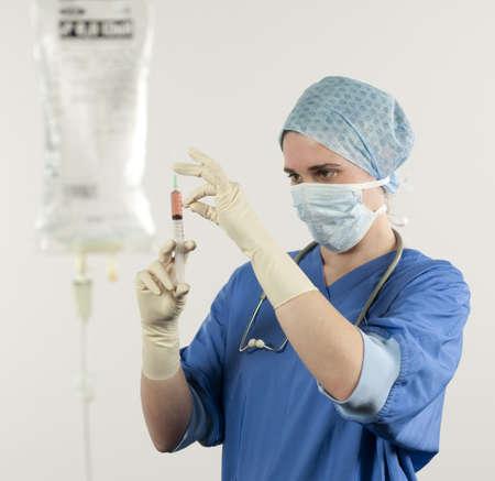 nurse controls syringe