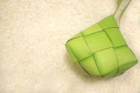 ketupat (rice dumpling) on rice background