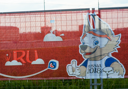 Russia, Moscow June 8, 2017 The official mascot of the 2018 Russian Football Cup in Russia wolf Zabivaka on the billboard with the symbols of the FIFA Confederations Cup 2017