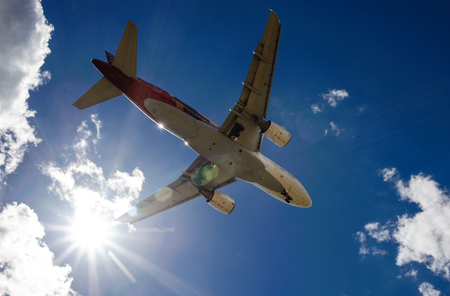 airfield: The plane on a background of blue sky and white clouds. Stock Photo